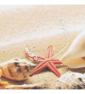 Bracelet en argent et oeil de sainte Lucie en clé de sol