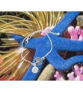 Bracelet composé d'un arbre de vie en argent et d'une breloque oeil de Sainte Lucie